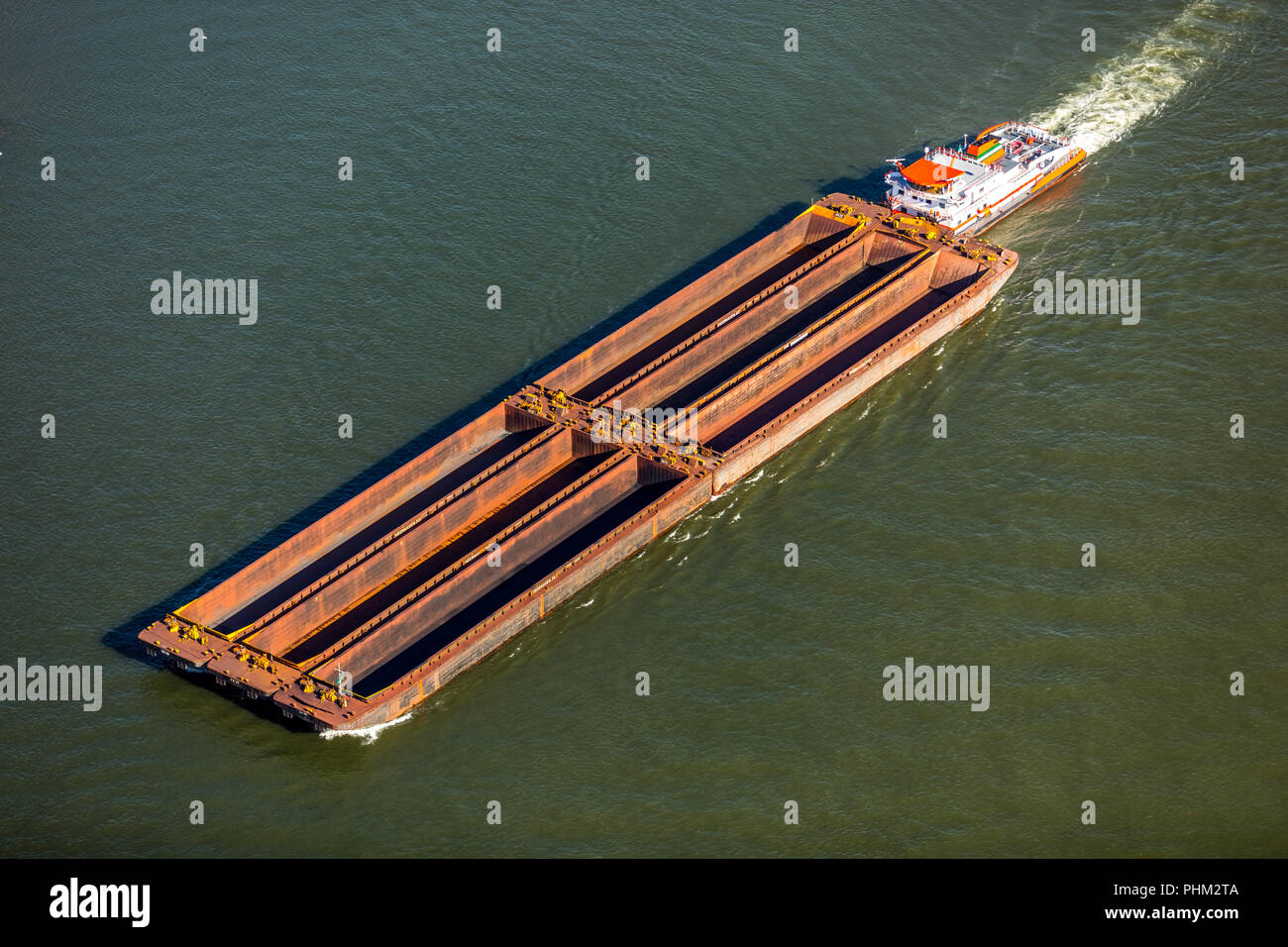 hight resolution of strong push boat with six barges on the rhine near wesel inland navigation rhine