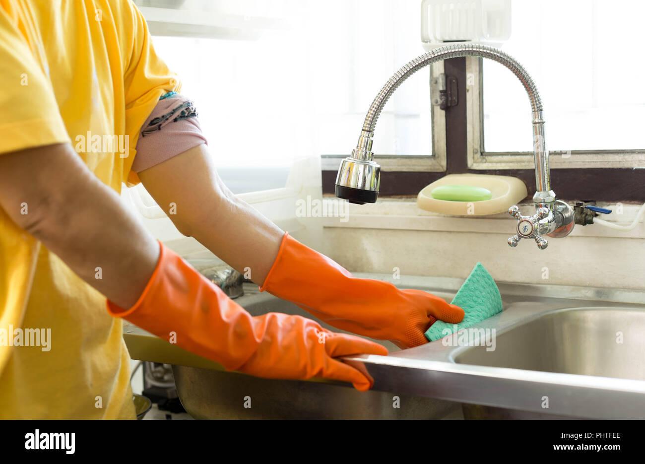 https www alamy com hand with orange glove cleaning kitchen sink image217512582 html