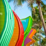 Abstract Row Of Brightly Painted Colorful Lifeguard Towers With Coconut Palm Trees On Miami Beach Promenade Stock Photo Alamy