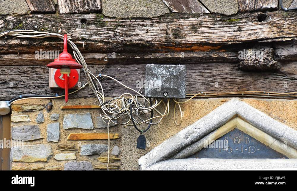 medium resolution of hazardous dangerous risky electric cabling wiring installazion outside of an an old house in rouen normandy france