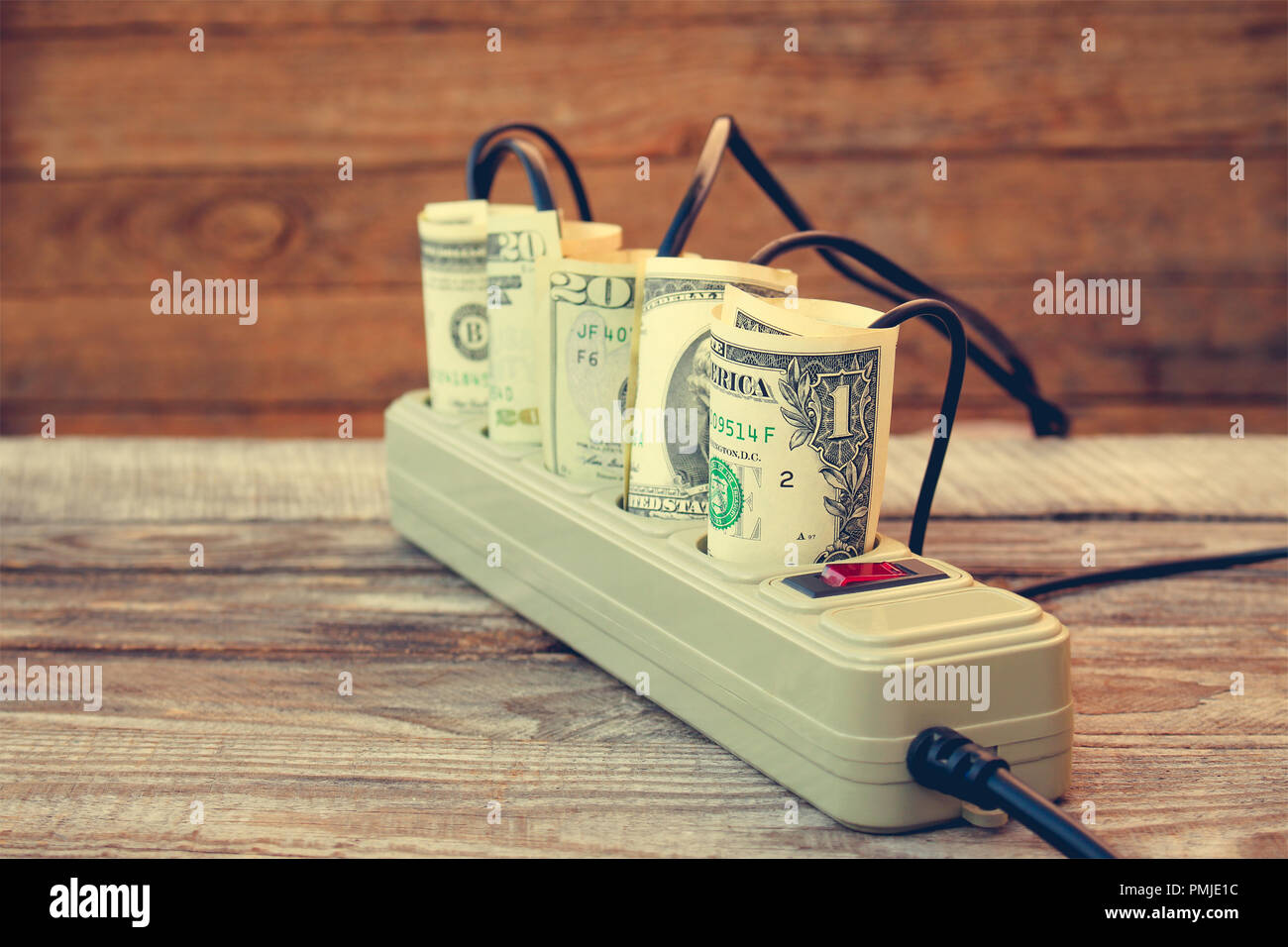 hight resolution of socket and money concept of energy savings toned image stock image