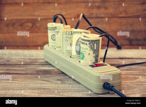small resolution of socket and money concept of energy savings toned image stock image