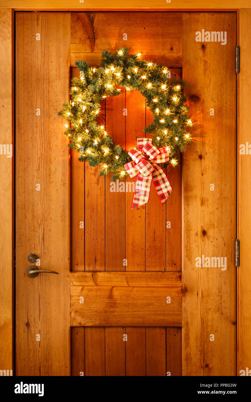 Beautiful Christmas Decorations Wreath With Ribbon Bow And Lights On Wooden Front Door Background Simple Rustic Country Style Holiday Home Decor Stock Photo Alamy