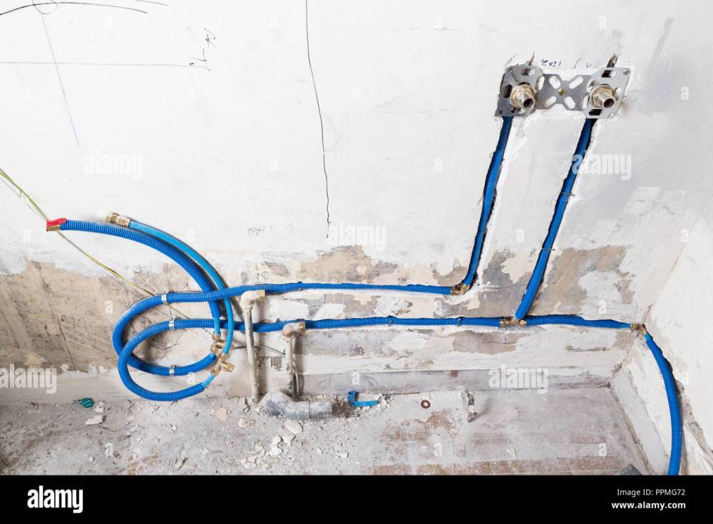 medium resolution of water pipes made of polypropylene pex in the wall plumbing in the house installation of sewer pipes in a bathroom of an apartment interior during re