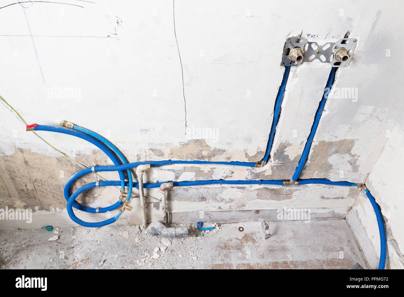 hight resolution of water pipes made of polypropylene pex in the wall plumbing in the house installation of sewer pipes in a bathroom of an apartment interior during re