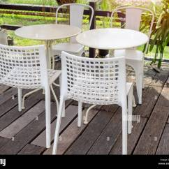 Retro Cafe Table And Chairs Chair Covers Rental Okc White Modern Mixed Match Round Tables On Old Wooden Floor Near The Garden In