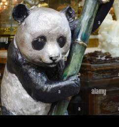 a bronze panda bear sculpture for sale in a home decor shop in chinatown san [ 1300 x 957 Pixel ]