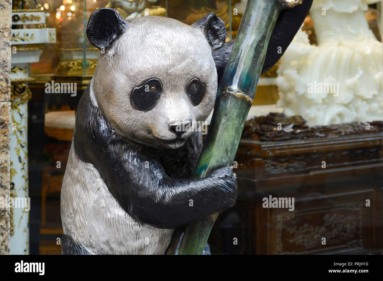hight resolution of a bronze panda bear sculpture for sale in a home decor shop in chinatown san