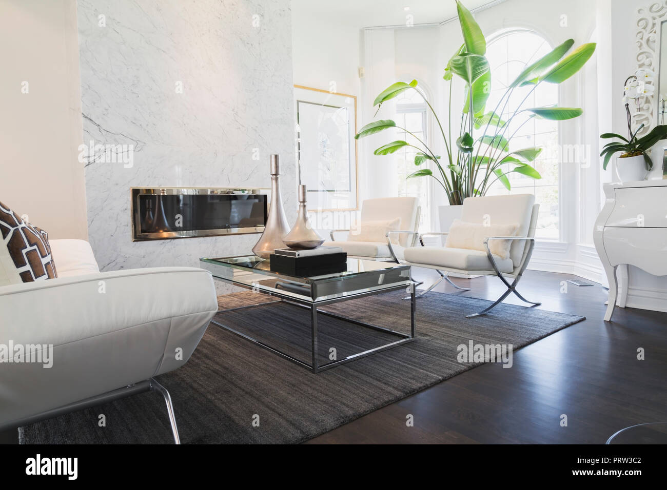 white leather chairs for living room tufted desk chair with and chrome sofa matching armchairs facing coffee table inside luxury residential home