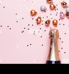 champagne bottle and scattering of golden shiny balls and confetti on pink background banner format [ 1300 x 656 Pixel ]