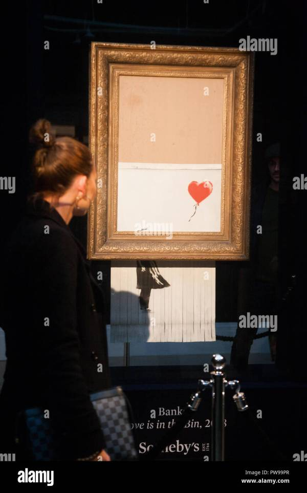 Banksy Girl With Red Balloon Stock &