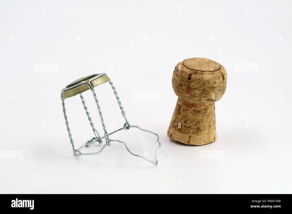 medium resolution of champagne cork with wire basket isolated on white stock image