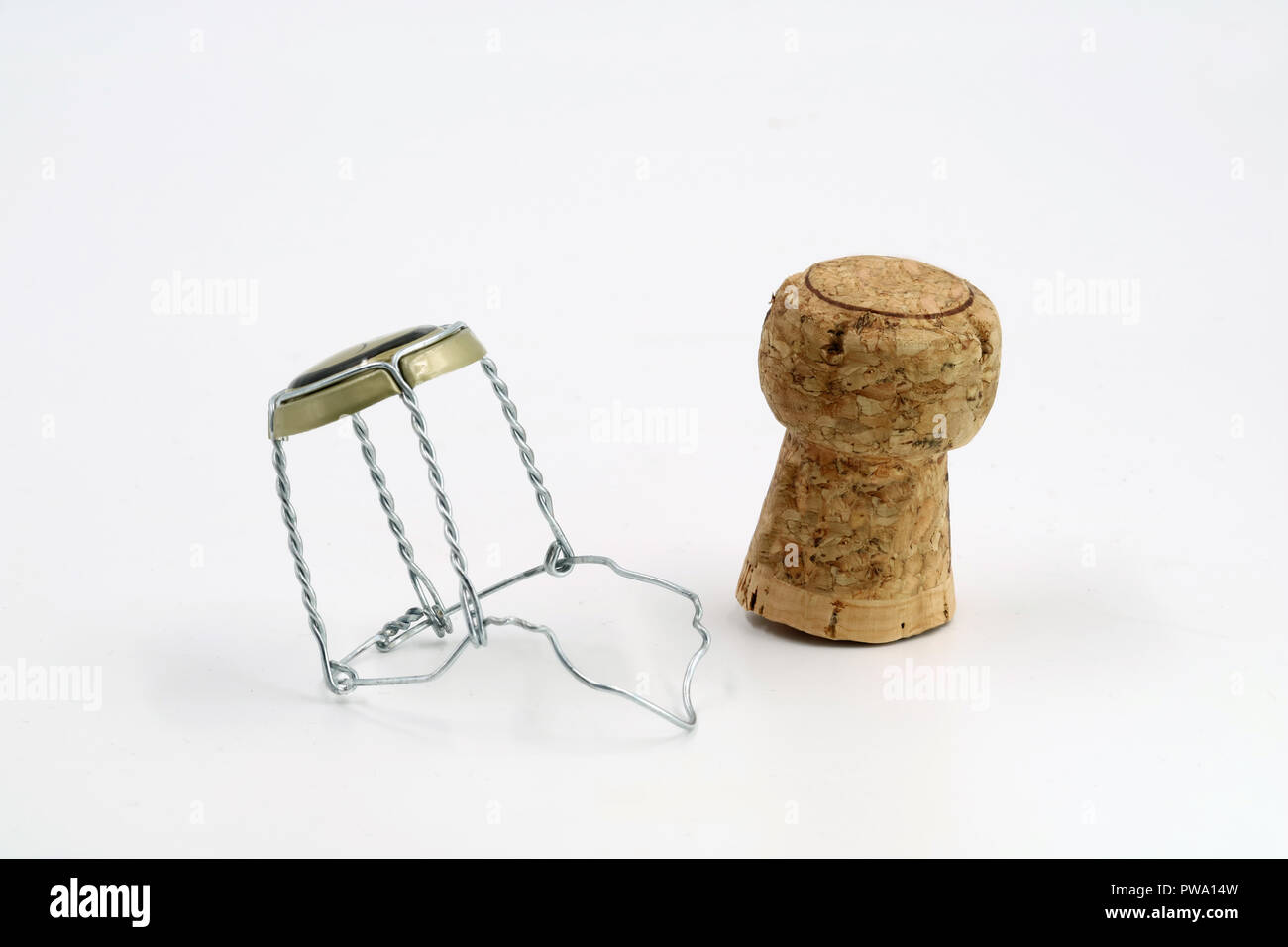 hight resolution of champagne cork with wire basket isolated on white stock image