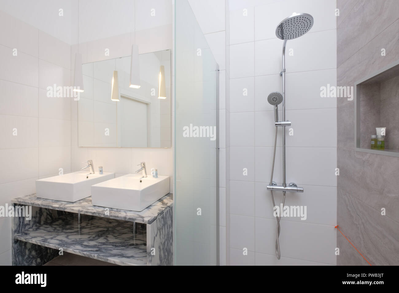 Bathroom With A Large Mirror Double Basins And A Wall