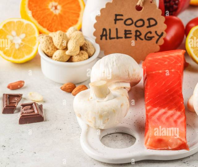 Allergy Food Concept Allergies To Fish Eggs Citrus Fruits Chocolate Mushrooms And Nuts Health And Medicine In Food White Background
