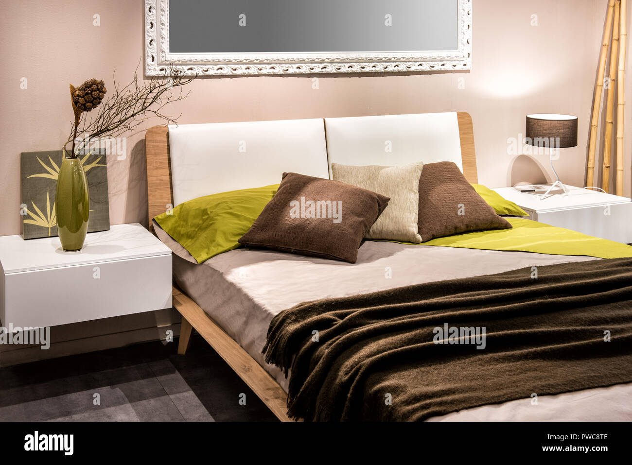 https www alamy com bedroom interior with four pillows on bed and mirror on wall image222161198 html