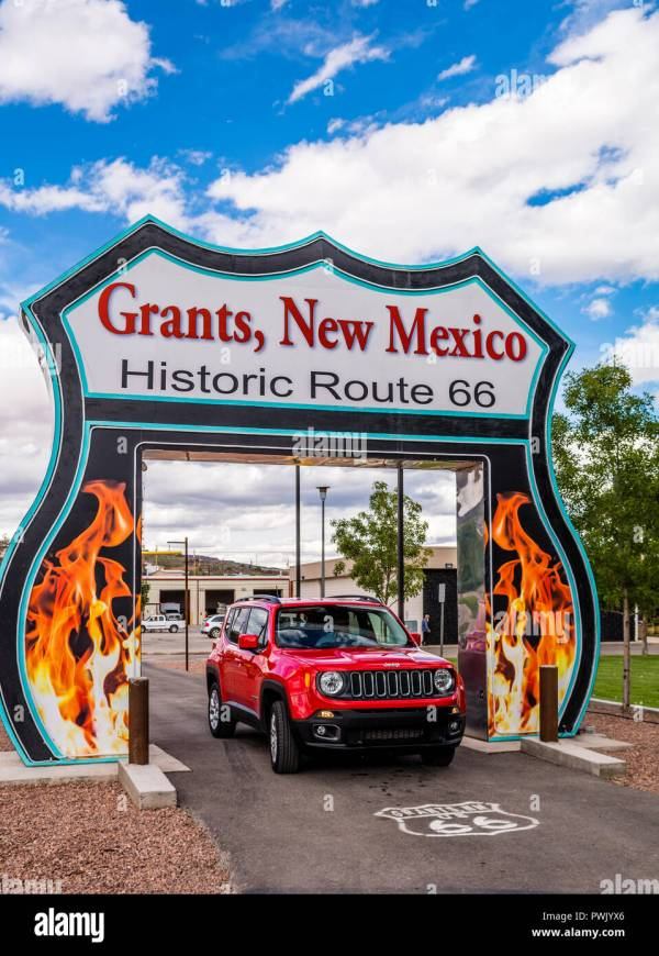Route 66 Neon Drive- Sign And Red Jeep Renegade In