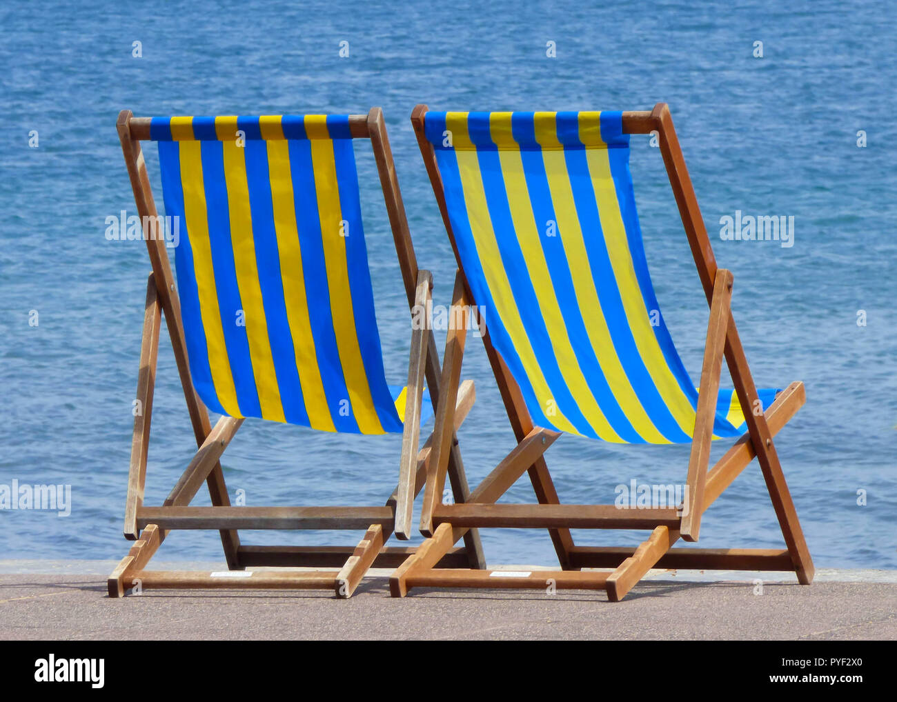 chair cover rentals victoria bc fairfield yellow deck chairs stock photos and