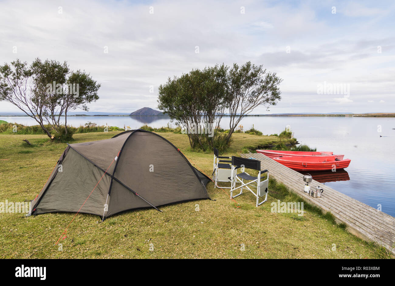 folding chairs for boats wood dining table with white camping site a tent two and at the coast of myvatn lake iceland