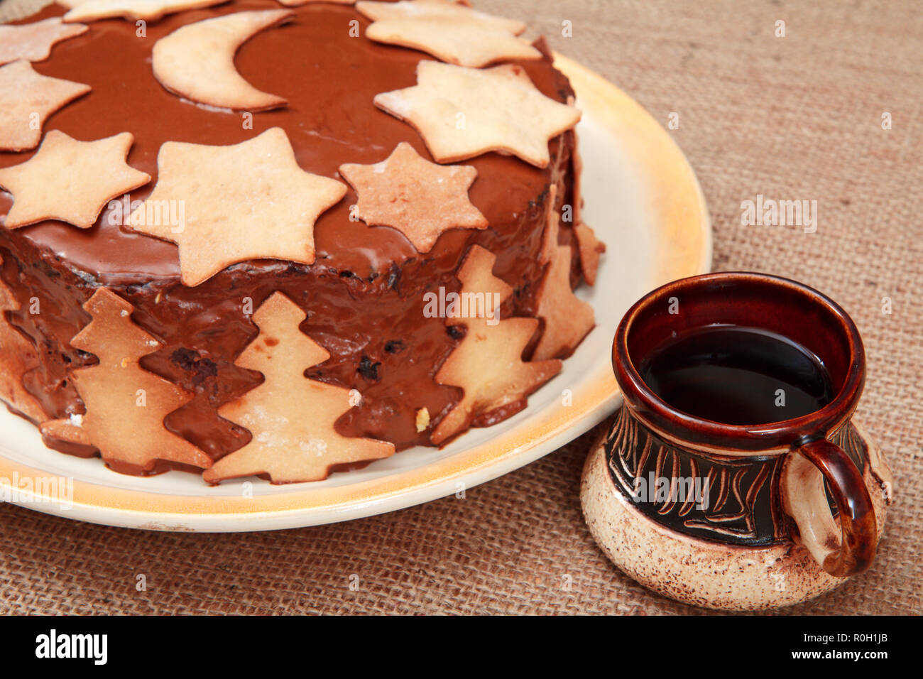 Homemade Chocolate Cake Decorated With Christmas Ornament And Cup Of