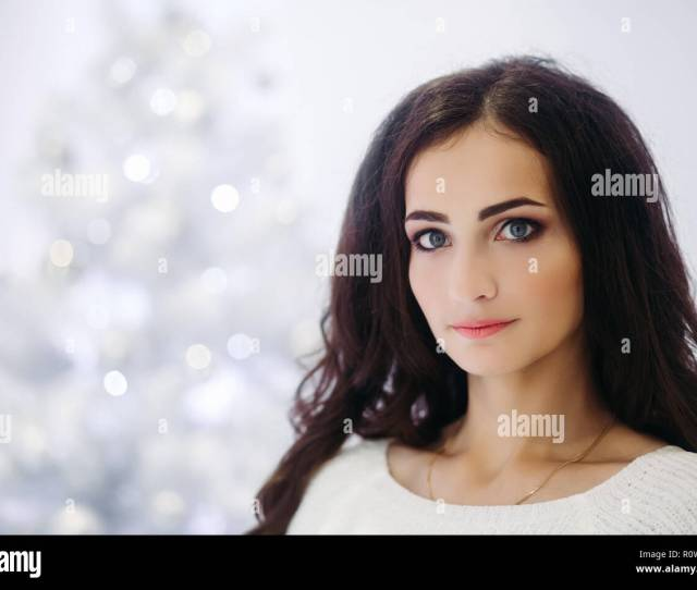 Gorgeous Brunette Woman With Perfect Make Up And Smooth Skin Wearing Gray Sweater Posing In Decorated Studio For New Year Holidays Beautiful Girl Loo