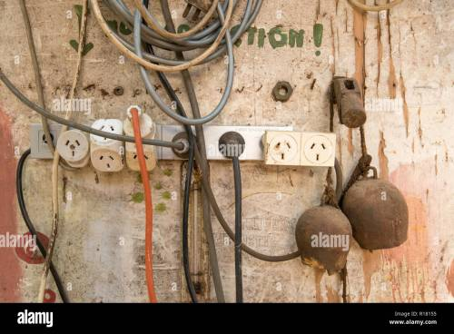 small resolution of an australian electrical power board with multiple plugs and leads attached and hanging on a wall