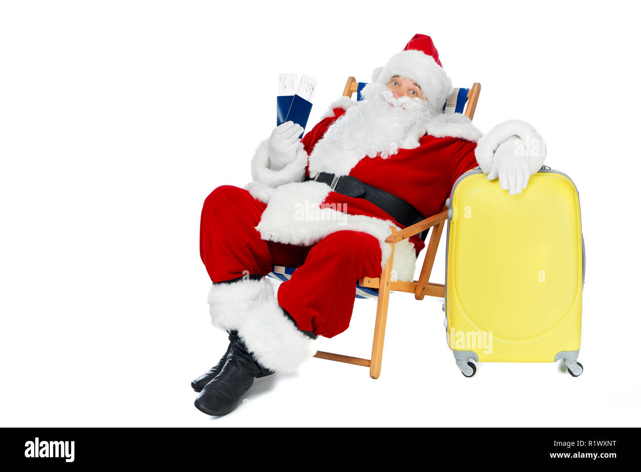 air travel beach chairs adams adirondack chair green santa claus holding two passports and tickets for christmas trip while sitting in with bag isolated on white