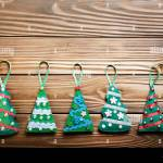 Handmade Rustic Green Felt Christmas Tree Decorations Flat Lying On Wooden Table Stock Photo Alamy