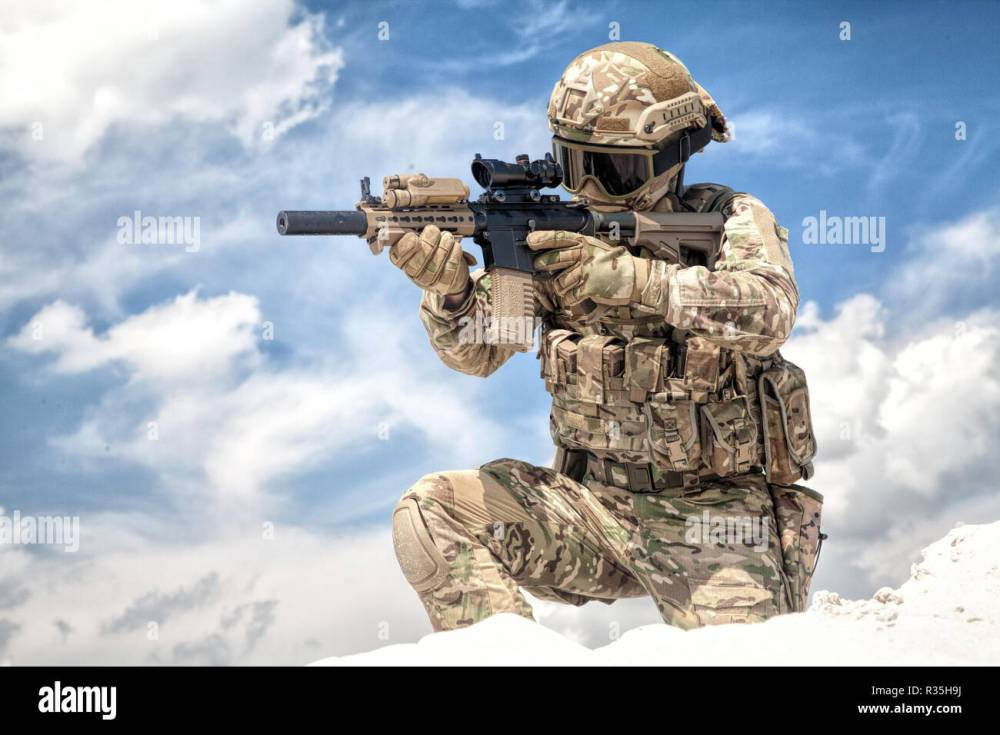 medium resolution of fully equipped with tactical ammunition airsoft player in military camouflage uniform aiming with optical sight