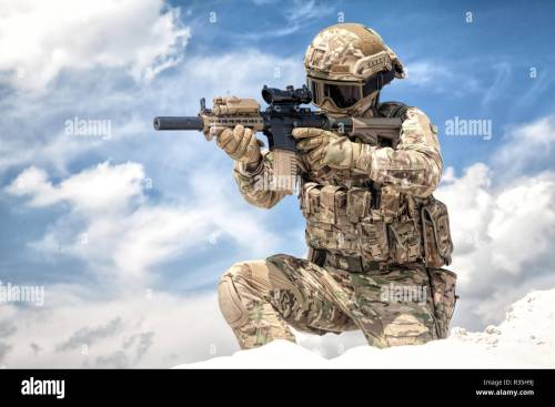 small resolution of fully equipped with tactical ammunition airsoft player in military camouflage uniform aiming with optical sight
