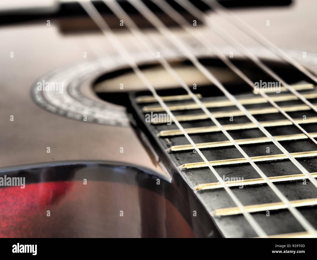 hight resolution of close up brown wooden classical guitar and guitar wires