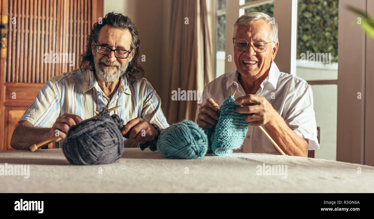 two retired men knitting