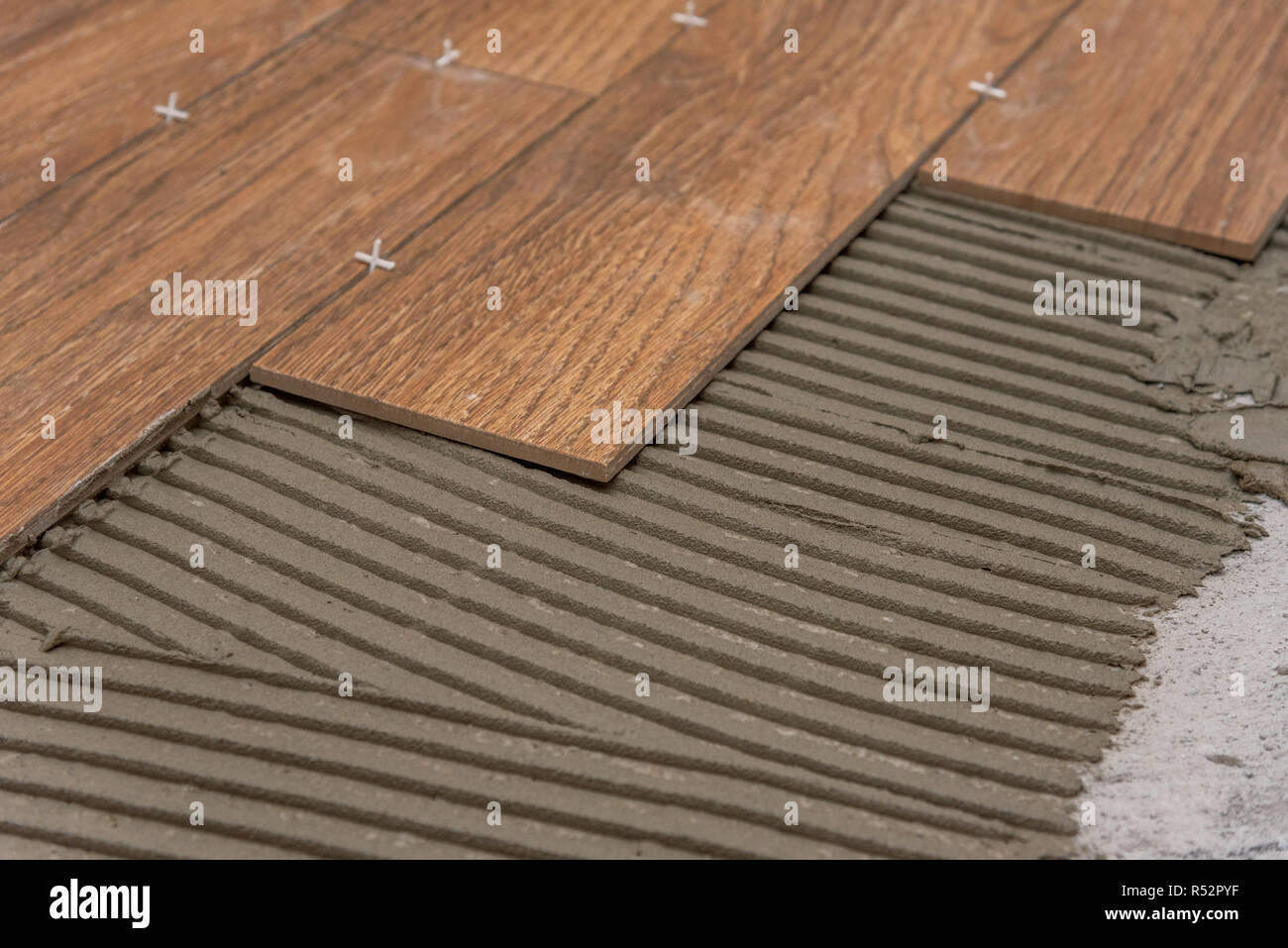https www alamy com ceramic tiles and tools for tiler floor tiles installation home improvement renovation ceramic tile floor adhesive mortar level image226869987 html