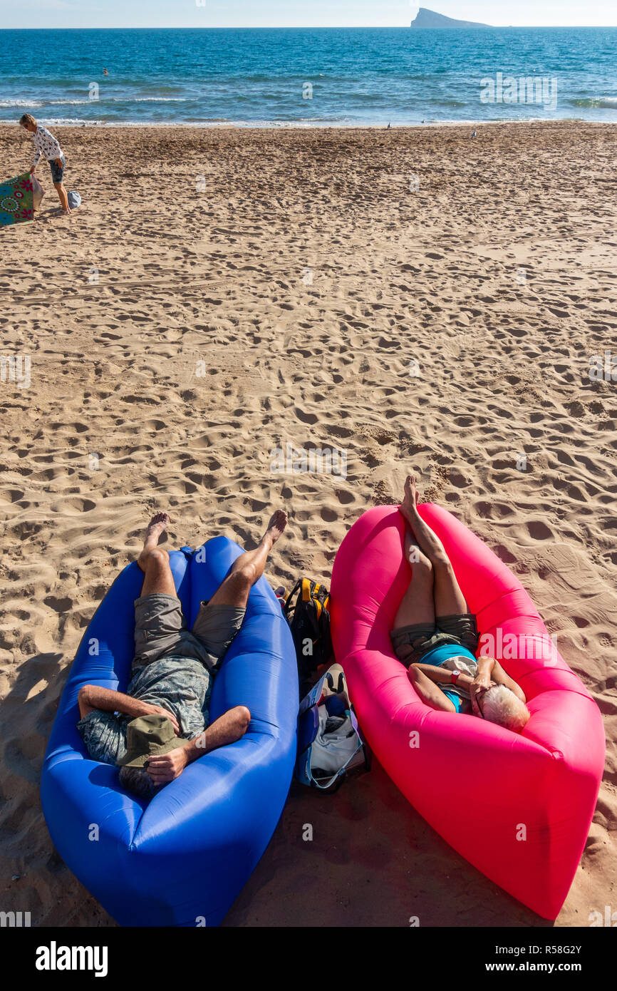 https www alamy com male and female tourists sitting on blue and red inflatable lips beach furniture sunbathing on an air lounger on the beach image226996307 html