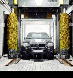 moscow russia 09 06 2018 black bmw in car wash [ 1300 x 956 Pixel ]