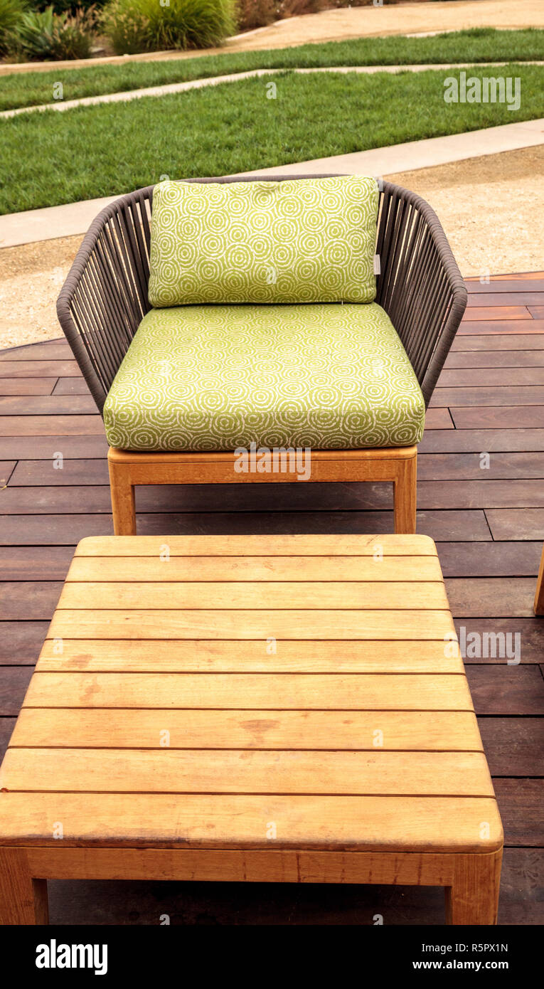 Outside Lounge Chairs Wood Patio Lounge Chairs With Green Cushions Stock Photo