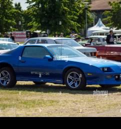 paaren im glien germany may 19 2018 muscle car chevrolet camaro iroc z z28 1985 die oldtimer show 2018  [ 1300 x 956 Pixel ]