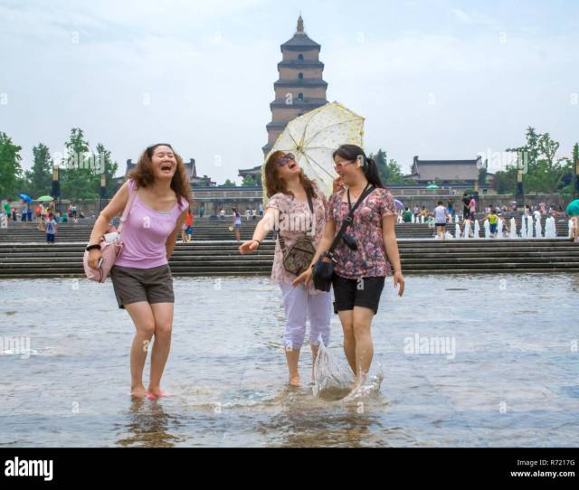 Local People Playing With The Water During Summer In The Music Fountain Dayan Pagoda Square