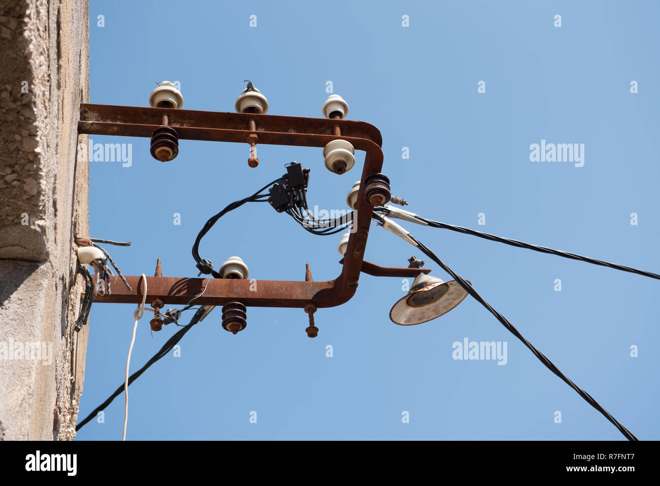 hight resolution of electric wires attached on an old stone house old architecture electricity transmission light