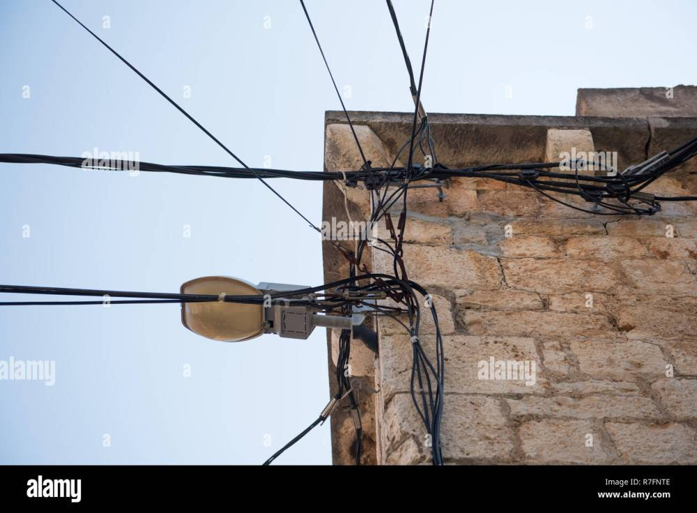 medium resolution of electric wires attached on an old stone house old architecture electricity transmission light