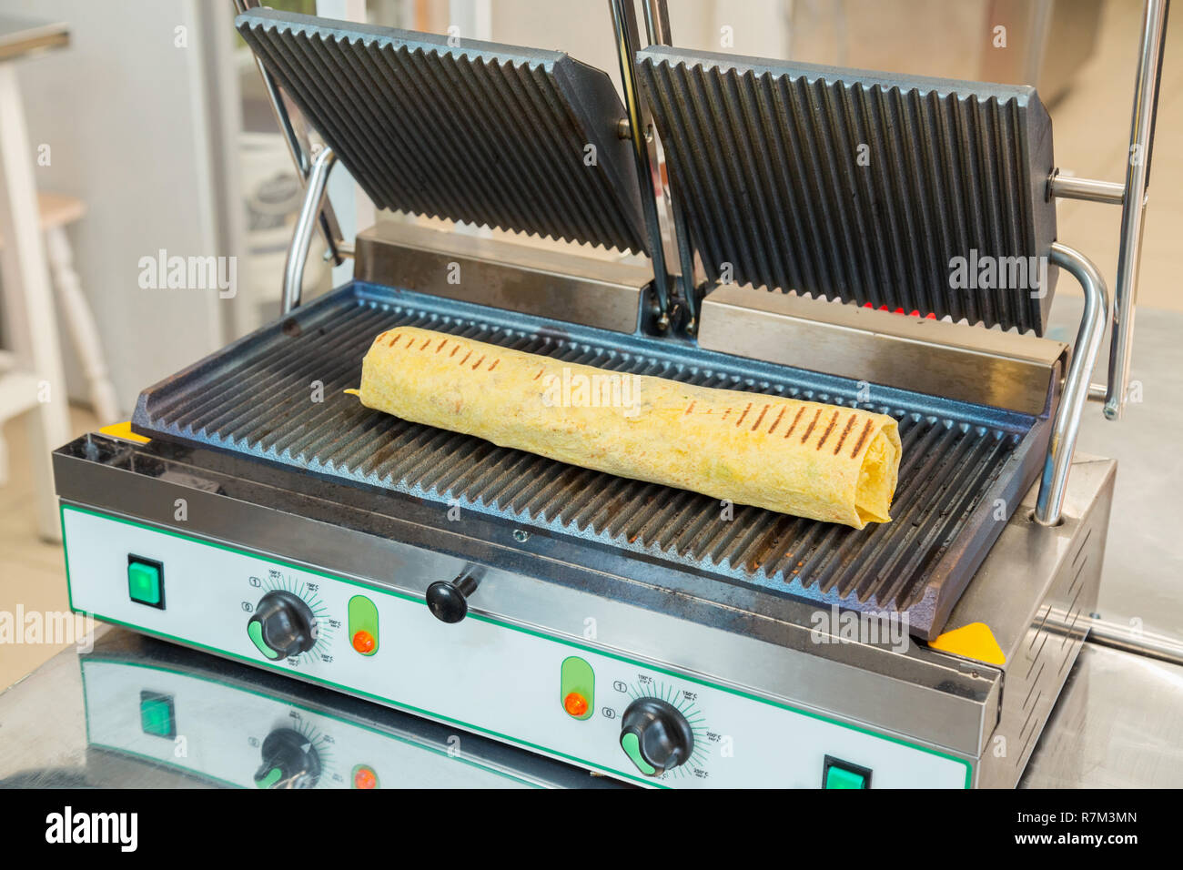 hight resolution of preparation of shawarma on an electric furnace stock image