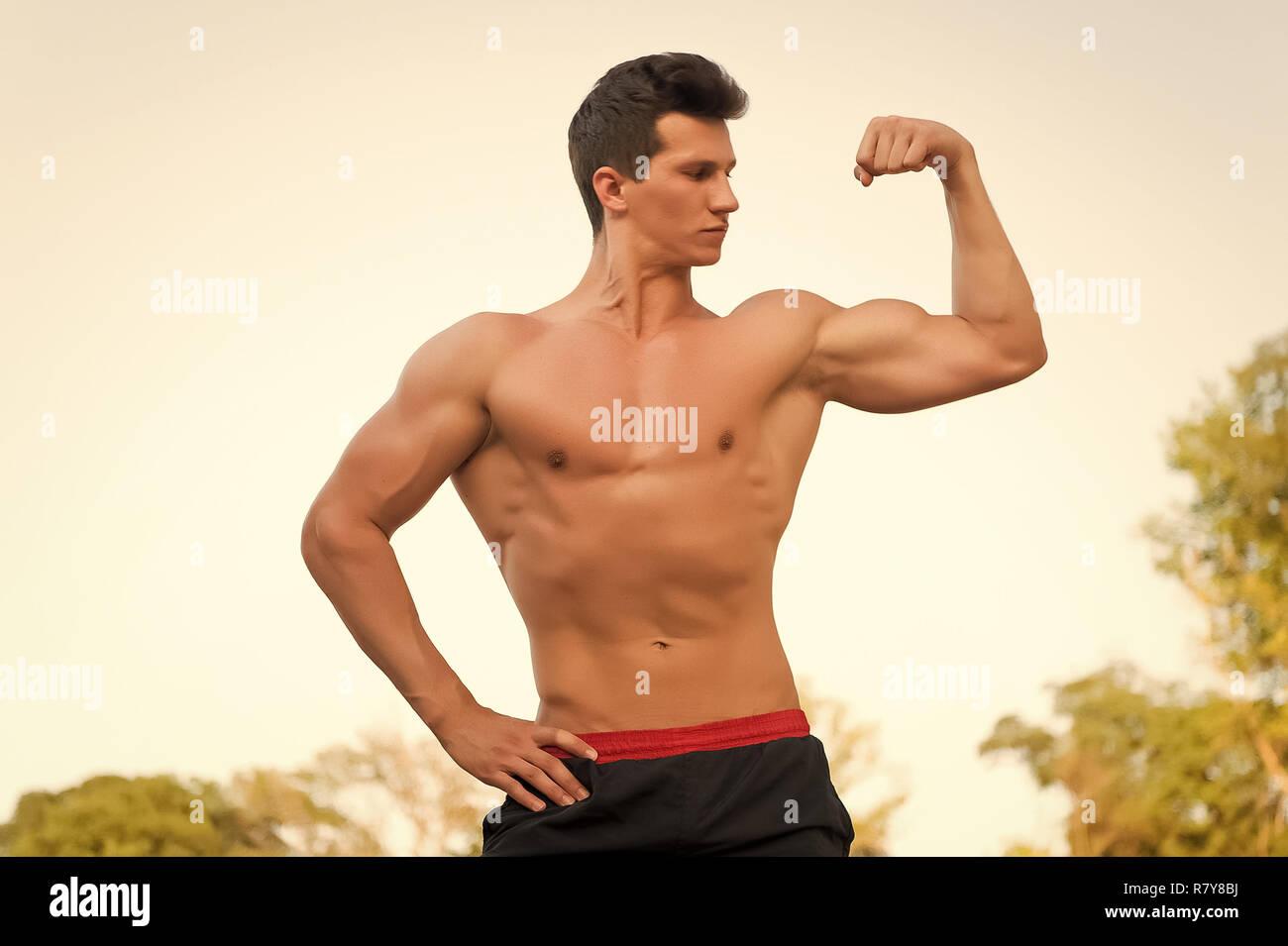 man flexing biceps arm