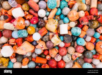 Beautiful wallpaper background of colorful jewelery beads of many shapes and materials Stock Photo Alamy