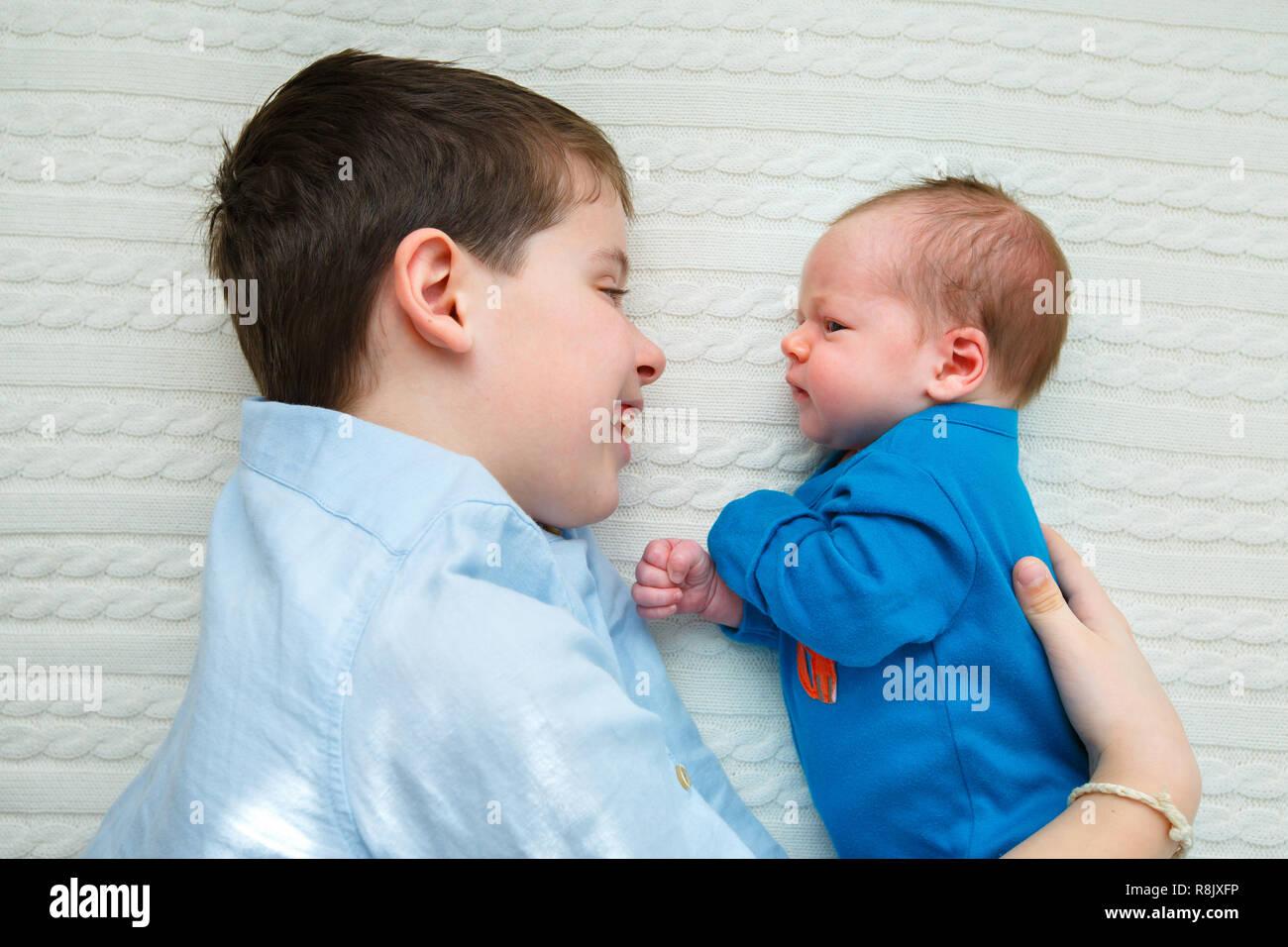 big brother hugging his