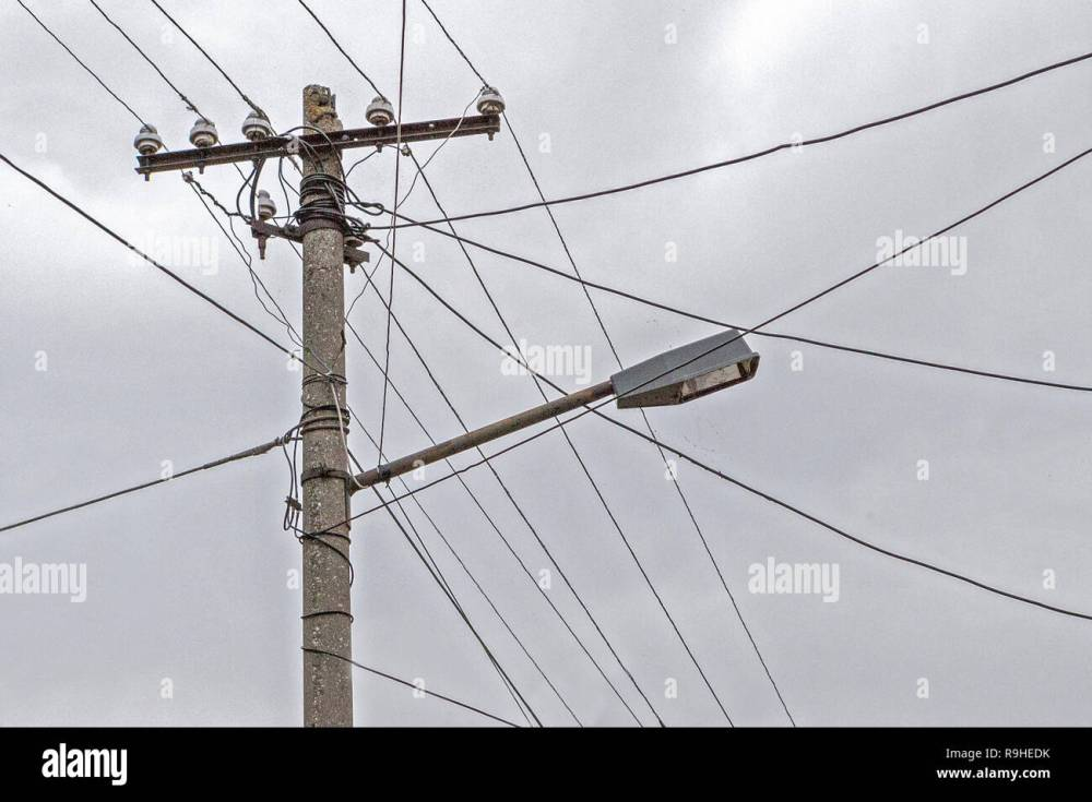 medium resolution of dual use of pole for telephone wires street light village albania