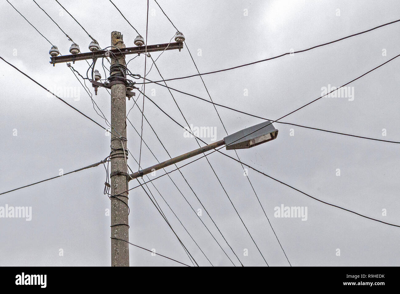 hight resolution of dual use of pole for telephone wires street light village albania