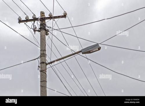 small resolution of dual use of pole for telephone wires street light village albania