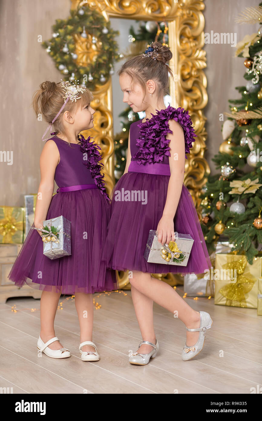 sofa chair for baby girl trundle bed christmas happy funny children child enjoying new year decoration studio with presents tree mirror and dressed in casual airy dresses