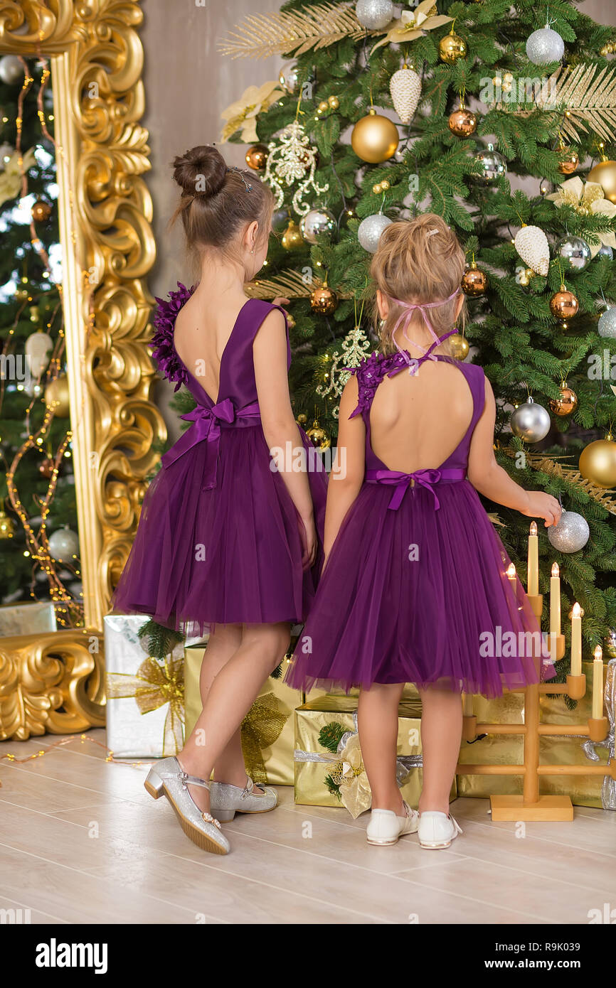sofa chair for baby girl ralph lauren sofas by henredon christmas happy funny children child enjoying new year decoration studio with presents tree mirror and dressed in casual airy dresses