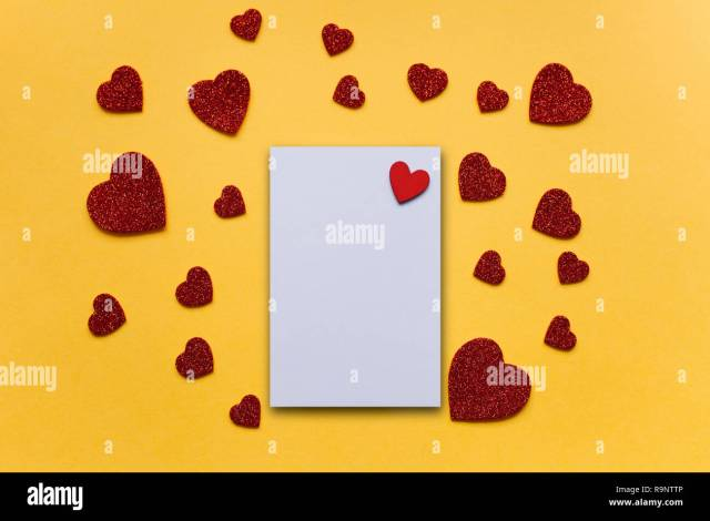 Blank sheet with red heart for text or write. Near many red hearts